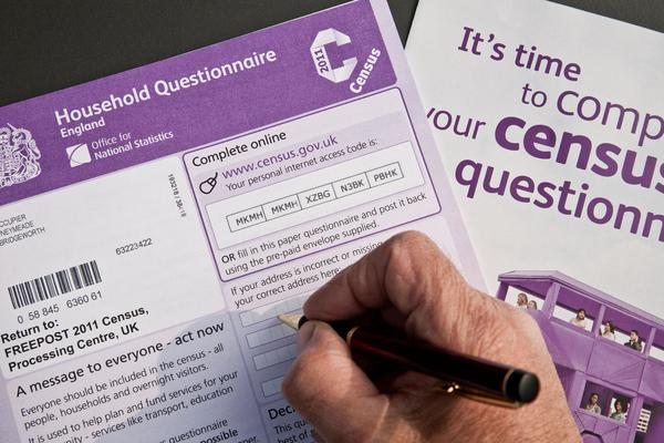 A person filling out the UK census