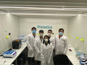 Boon Lim and his team at Heathrow, wearing masks and lab coats.